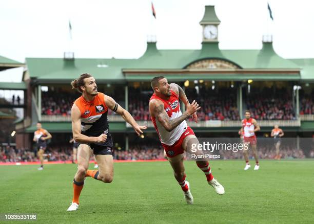 Phil Davis of the Giants competes for the ball against Lance Franklin of the Swans during the AFL Second Elimination Final match between the Sydney...