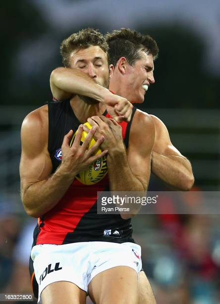 Phil Davis of the Giants contests the ball against Cale Hooker of the Bombers during the round three of the NAB Cup AFL match between the Greater...