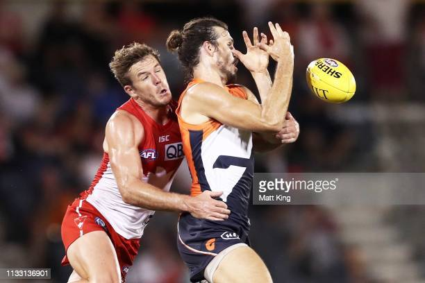 Phil Davis of the Giants is challenged by Luke Parker of the Swans during the 2019 JLT Community Series AFL match between the Greater Western Sydney...