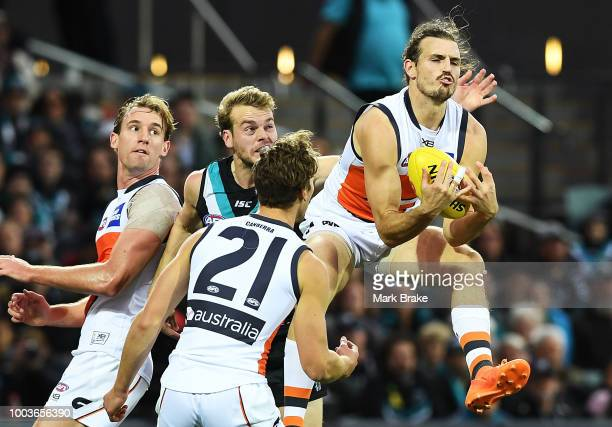 Phil Davis of the Giants marks in front of Jack Watts of Port Adelaide during the round 18 AFL match between the Port Adelaide Power and the Greater...