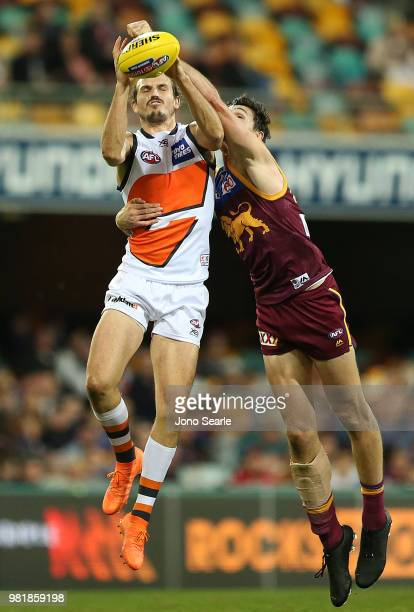 Phil Davis of the Giants marks the ball during the round 14 AFL match between the Brisbane Lions and the Greater Western Sydney Giants at The Gabba...
