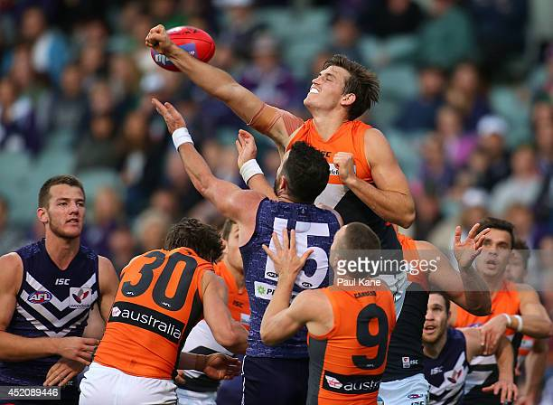 Phil Davis of the Giants spoils the mark for Ryan Crowley of the Dockers during the round 17 AFL match between the Fremantle Dockers and the Greater...
