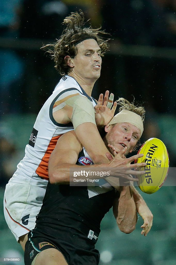 Phil Davis of the Giants takes Brad Ebert of the Power high during the round 18 AFL match between the Port Adelaide Power and the Greater Western Sydney Giants at Adelaide Oval on July 24, 2016 in Adelaide, Australia.