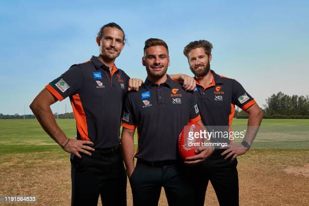 Phil Davis, Stephen Coniglio and Callan Ward pose for a photo during a Greater Western Sydney Giants AFL media opportunity at WestConnex Centre on...