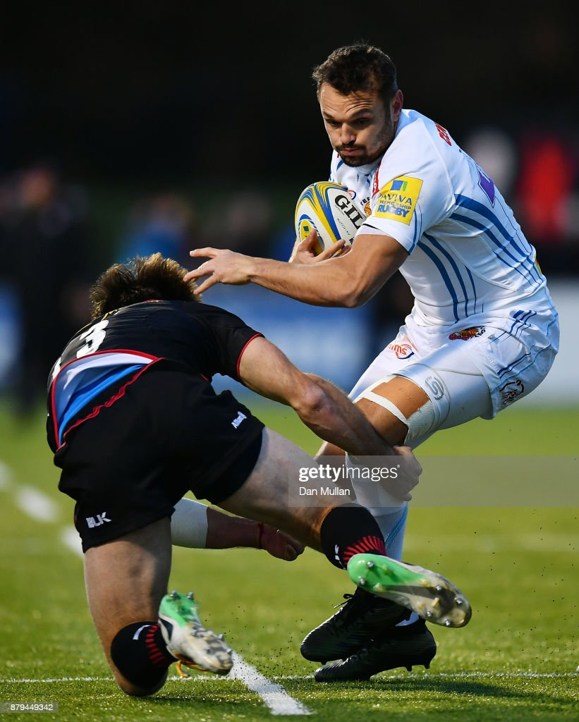 Phil Dollman of Exeter Chiefs hands off Marcelo Bosch of Saracens during the Aviva Premiership match between Saracens and Exeter Chiefs at Allianz Park on November 26, 2017 in Barnet, England.