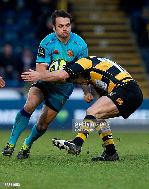 Phil Dollman of Exeter is tackled by Ryan Davis of Wasps during the LV= Cup match between London Wasps and Exeter Chiefs at Adams Park on January 28...