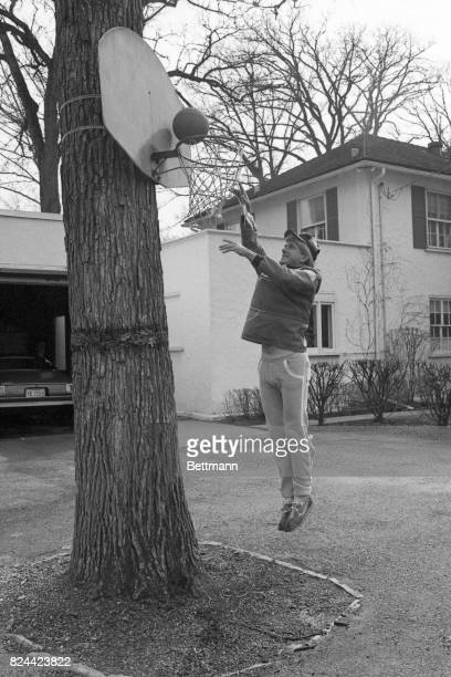 Phil Donahue tosses a few baskets in the side yard of his home here in this Chicago suburb where he lives with his four boys Michael Kevin Daniel and...