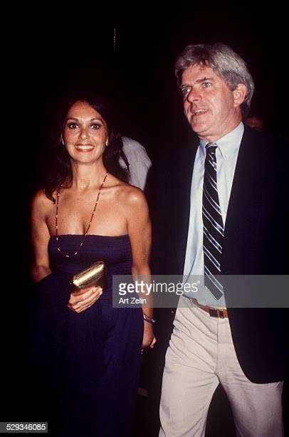 Phil Donahue with his wife Marlo Thomas he is wearing a shirt and tie she is in a blue strapless circa 1970 New York