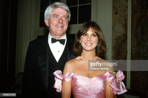 Phil Donohue and Marlo Thomas pose for a photograph at Gloria Steinem's 50th birthday celebration May 23 1984 in New York City