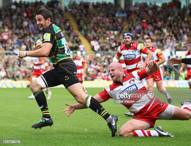 Phil Downey of Northampton Saints breaks through to score a try during the AVIVA Premiership match between Northampton Saints and Gloucester at...
