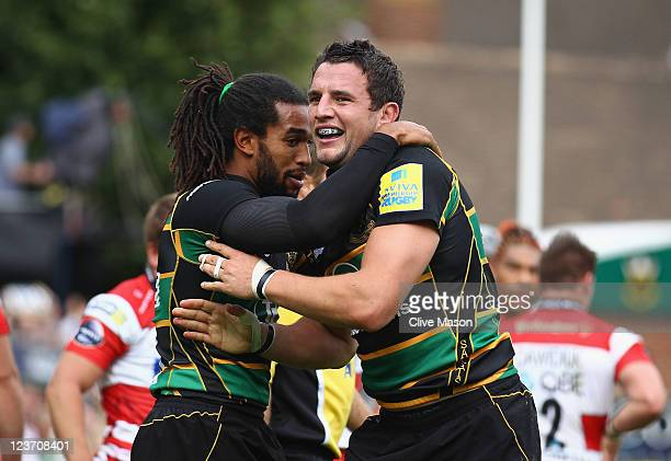 Phil Downey of Northampton Saints is congratulated for his try during the AVIVA Premiership match between Northampton Saints and Gloucester at...