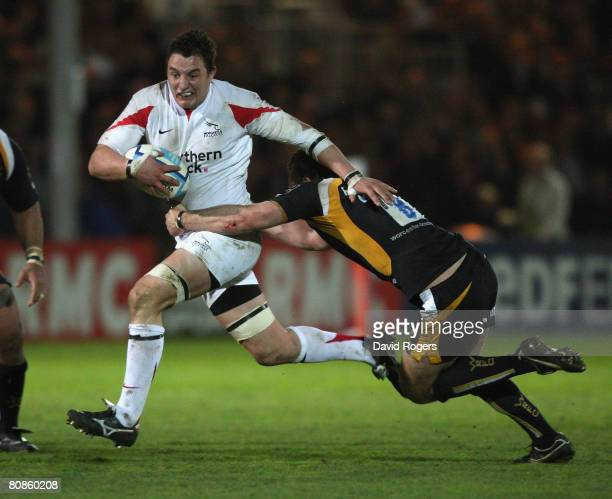 Phil Dowson of Newcastle charges upfield and is tackled by Kai Horstmann during the European Challenge Cup semi final match between Worcester...