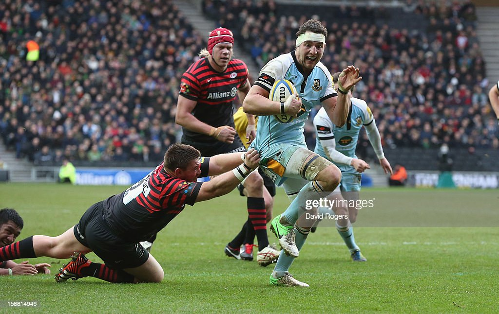 Phil Dowson of Northampton breaks clear to score a try during the Aviva Premiership match between Saracens and Northampton Saints at stadiumMK on December 30, 2012 in Milton Keynes, England.