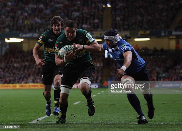 Phil Dowson of Northampton charges to the line to score the first try during the Heineken Cup Final match between Leinster and Northampton Saints at...