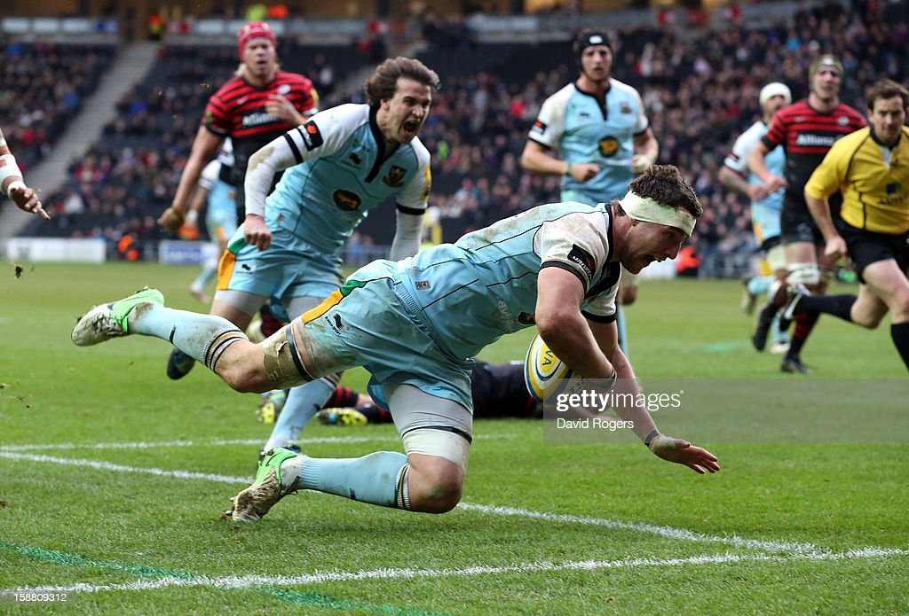 Phil Dowson of Northampton dives over for a try during the Aviva Premiership match between Saracens and Northampton Saints at stadiumMK on December 30, 2012 in Milton Keynes, England.