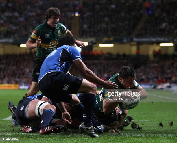 Phil Dowson of Northampton dives over to score the first try during the Heineken Cup Final match between Leinster and Northampton Saints at the...