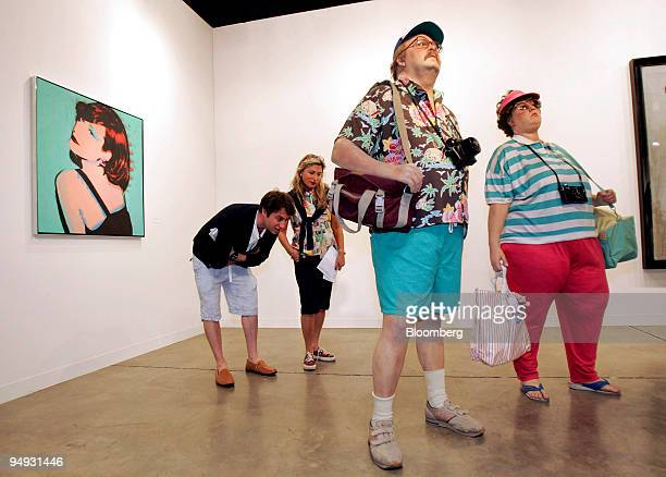 Phil Dubrovsky of Toronto left and his mother Elaine Dubrovsky of Montreal second from left take a closer look at Duane Hanson's 'Tourists II' on...