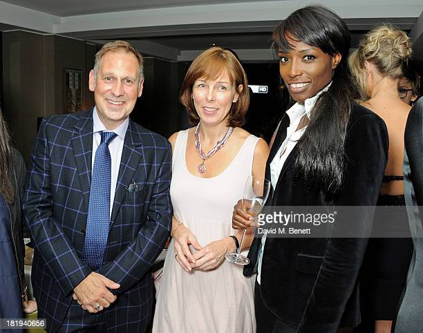Phil EdgarJones Nicola Ibison and Lorraine Pascale attend the Sky Living rebrand dinner at the Greenhouse Restaurant on September 26 2013 in London...