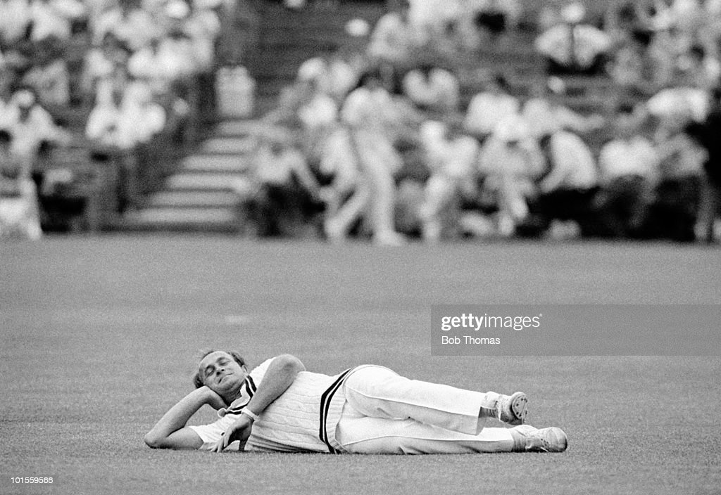 Phil Edmonds of Middlesex lies on the ground during the Northamptonshire v Middlesex Nat West Trophy match played at the County Ground Northampton on the 25th June 1986.