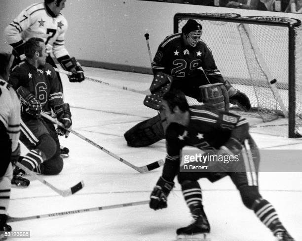Phil Esposito Harry Howell and goalie Ken Dryden in action during an All Star Game circa 1970's