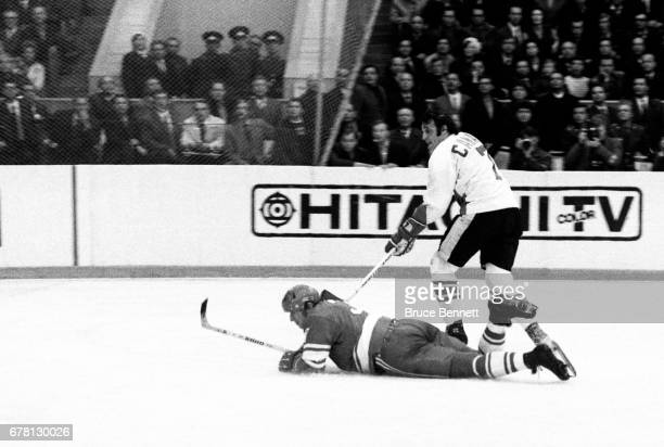 Phil Esposito of Canada knocks down Vladimir Lutchenko of the Soviet Union during a game in the 1972 Summit Series circa September 1972 at the...