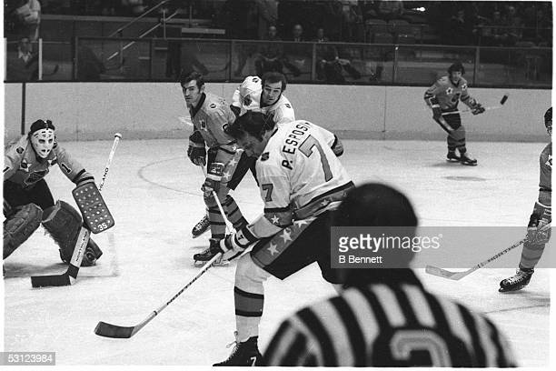 Phil Esposito of the Boston Bruins and Team East looks to shoot against his brother Tony Esposito of the Chicago Blackhawks and Team West as Ken...
