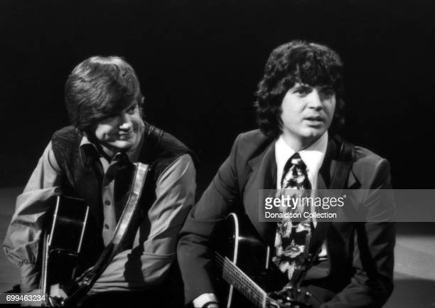 Phil Everly and Don Everly of the rock and roll band The Everly Brothers perform on a TV show in circa 1970 in London England