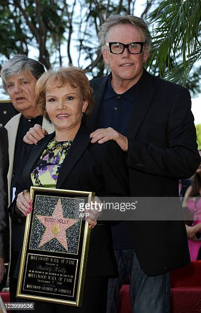Phil Everly Maria Elena Holly and Gary Busey attend the Buddy Holly Hollywood Walk Of Fame Induction Ceremony in Hollywood California September 7...