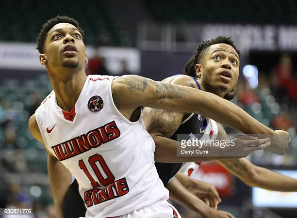 Phil Fayne of the Illinois State Redbirds and Pat Birt of the Tulsa Golden Hurricane fight for position after a free throw attempt during the second...