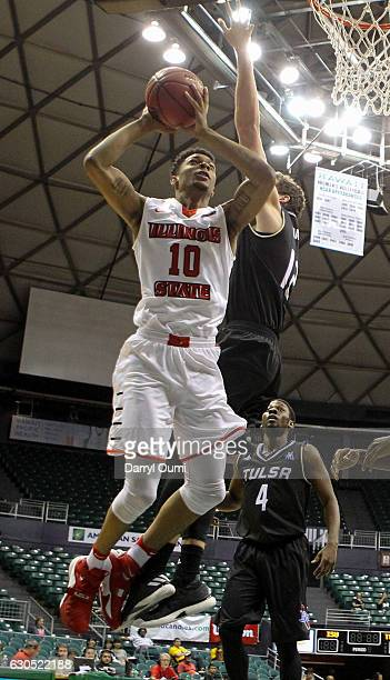 Phil Fayne of the Illinois State Redbirds attempts to slide past Will Magnay of the Tulsa Golden Hurricane during the first half of the Diamond Head...