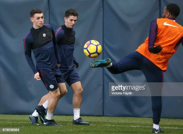 Phil Foden and Brahim Diaz in action during training at Manchester City Football Academy on November 24 2017 in Manchester England