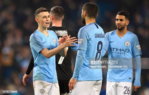 Phil Foden and Ilkay Gundogan of Manchester City celebrate following the FA Cup Third Round match between Manchester City and Rotherham United at the...