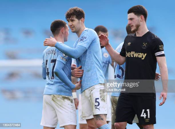 Phil Foden and John Stones of Manchester City celebrate following their team's victory in the Premier League match between Manchester City and West...
