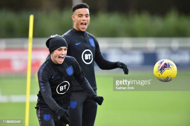 Phil Foden and Mason Greenwood of England U21s takes part in a training session at St Georges Park on November 11, 2019 in Burton-upon-Trent, England.