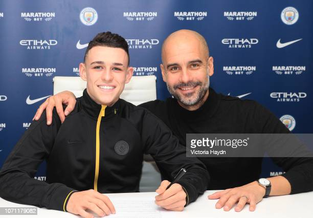Phil Foden and Pep Guardiola at Manchester City Football Academy on December 10, 2018 in Manchester, England.