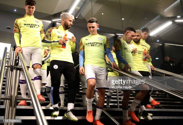 Phil Foden and Sergio Aguero of Manchester City walk through the tunnel prior to the FA Cup Third Round match between Manchester City and Port Vale...
