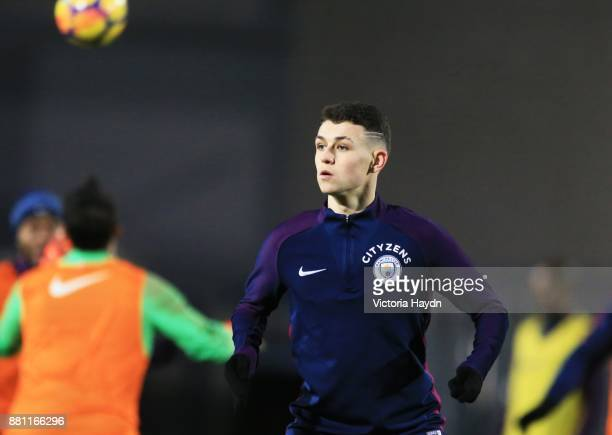 Phil Foden in action during training at Manchester City Football Academy on November 28 2017 in Manchester England