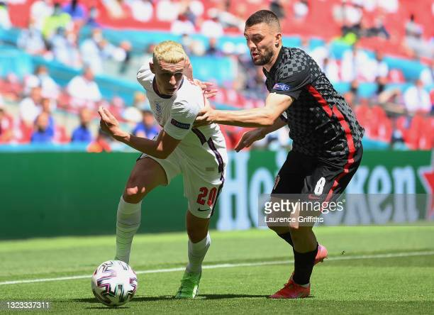 Phil Foden of England battles for possession with Mateo Kovacic of Croatia during the UEFA Euro 2020 Championship Group D match between England and...