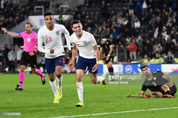 Phil Foden of England celebrates after scoring his teams second goal of the match during the UEFA European U21 2021 Championship Qualifier between...