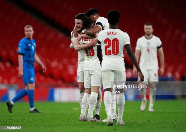 Phil Foden of England celebrates with Declan Rice Tyrone Mings and Bukayo Saka after scoring their team's third goal during the UEFA Nations League...