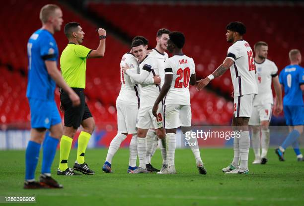 Phil Foden of England celebrates with Jadon Sancho Declan Rice Bukayo Saka and Tyrone Mings of England after scoring their team's third goal during...