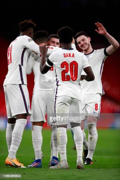 Phil Foden of England celebrates with Tammy Abraham Jadon Sancho Declan Rice and Bukayo Saka after scoring their team's third goal during the UEFA...