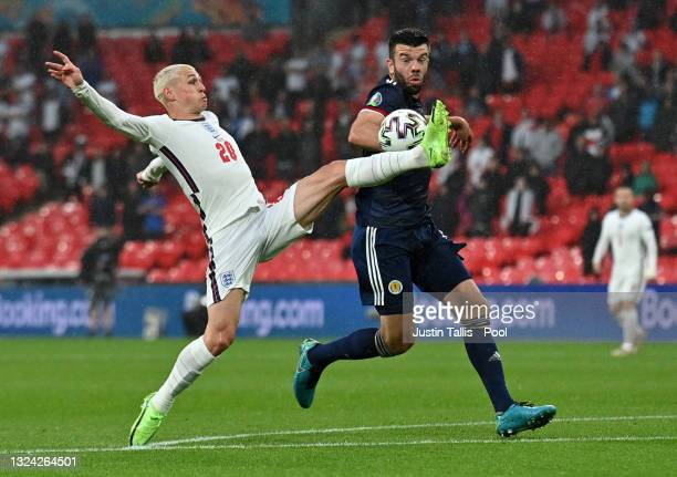 Phil Foden of England controls the ball whilst under pressure from Grant Hanley of Scotland during the UEFA Euro 2020 Championship Group D match...