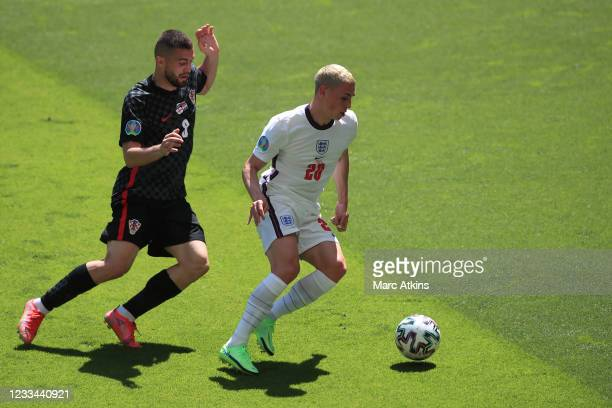 Phil Foden of England in action with Mateo Kovacic of Croatia during the UEFA Euro 2020 Championship Group D match between England and Croatia on...