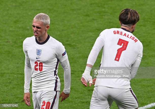 Phil Foden of England is replaced by team mate Jack Grealish during the UEFA Euro 2020 Championship Group D match between England and Scotland at...