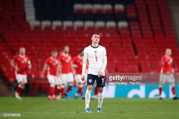 Phil Foden of England looks dejected after conceding their side's first goal scored by Jakub Moder of Poland during the FIFA World Cup 2022 Qatar...
