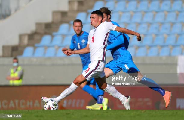 Phil Foden of England runs with the ball during the UEFA Nations League group stage match between Iceland and England at Laugardalsvollur National...