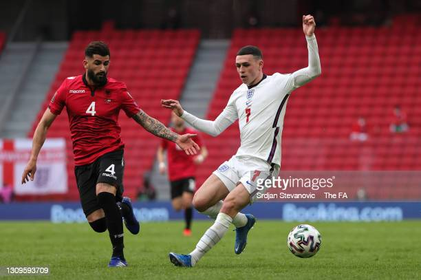 Phil Foden of England runs with the ball whilst under pressure from Elseid Hysaj of Albania during the FIFA World Cup 2022 Qatar qualifying match...