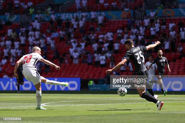 Phil Foden of England shoots whilst under pressure from Josko Gvardiol of Croatia during the UEFA Euro 2020 Championship Group D match between...