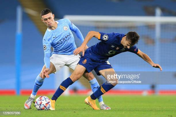 Phil Foden of Man City and Fabio Vieira of Porto during the UEFA Champions League Group C match between Manchester City and FC Porto at Etihad...